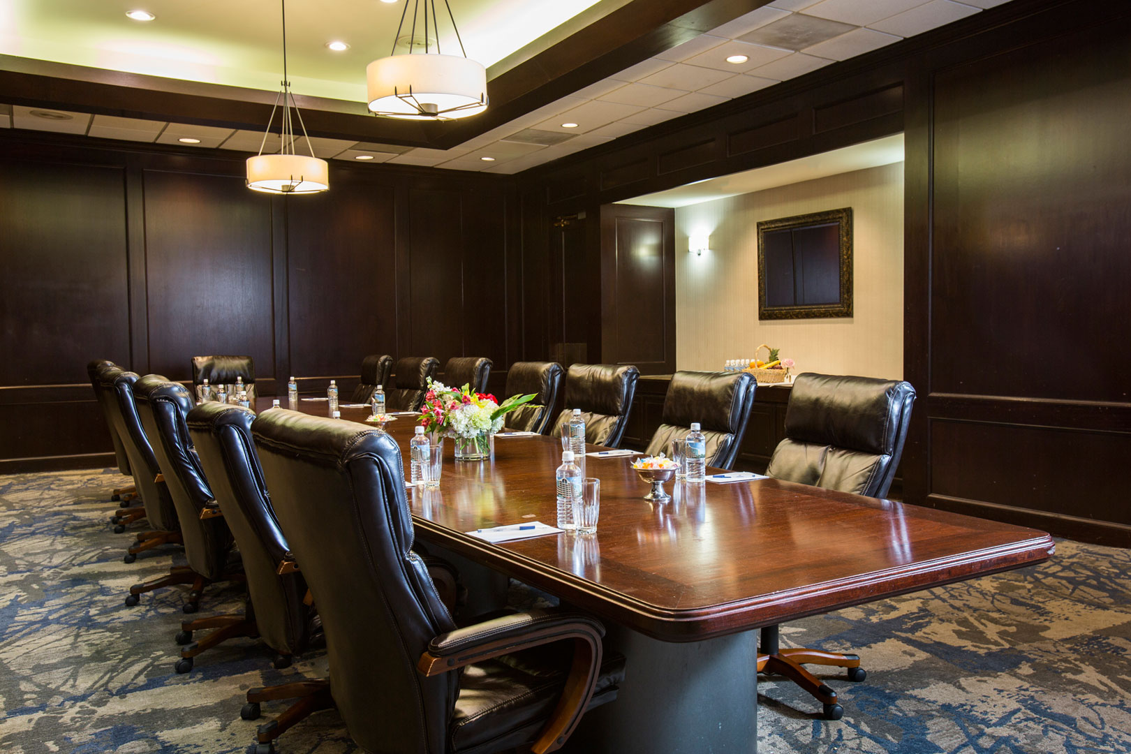 long meeting table with office chairs