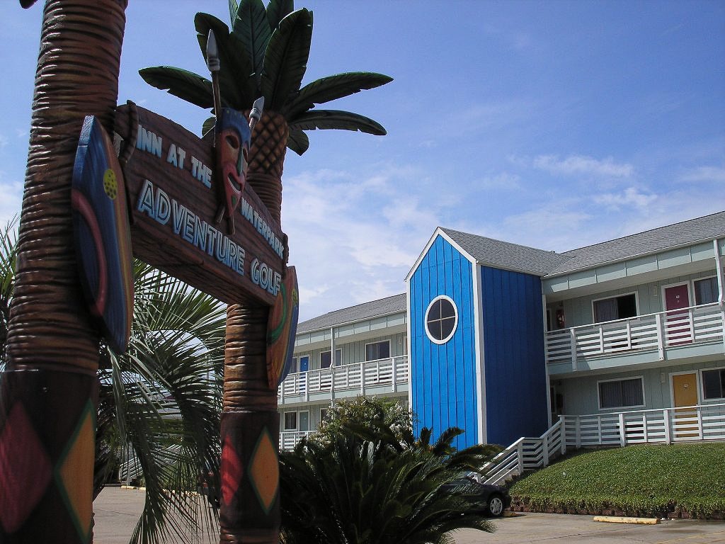 outside view showcasing hotel sign and building