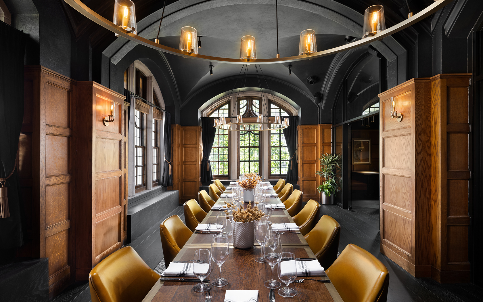 private dining room with long rectangular table and yellow seats