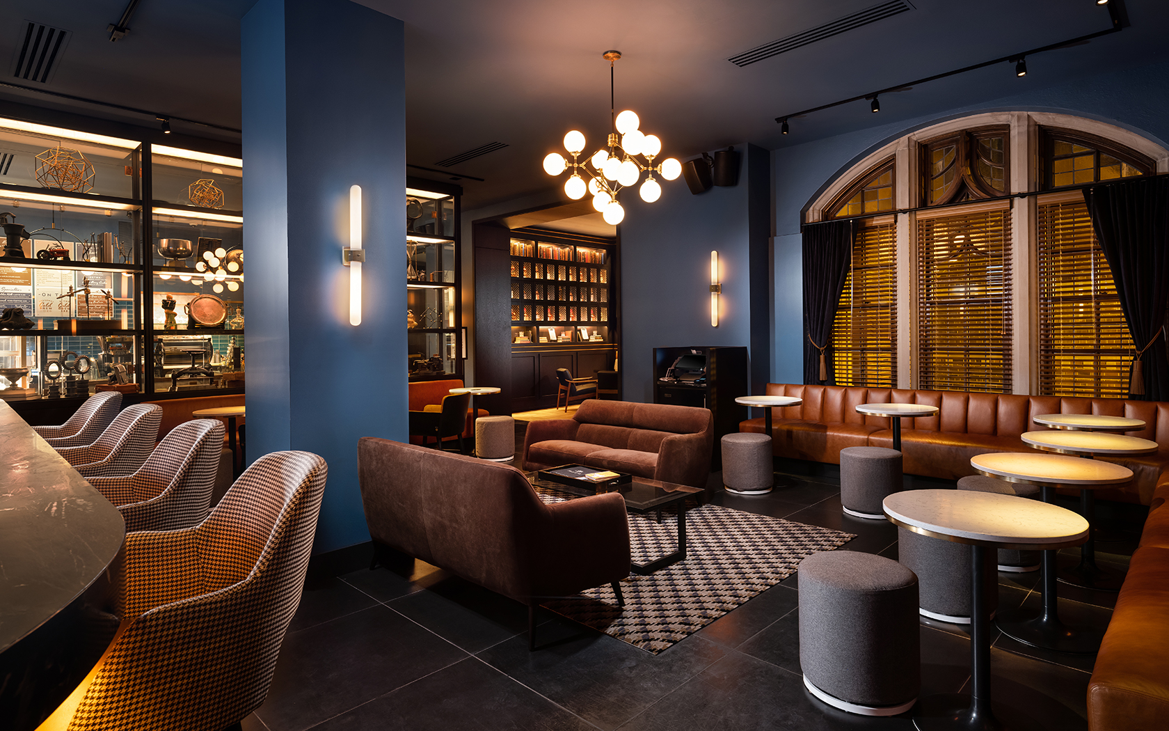 large bar seating area with blue walls