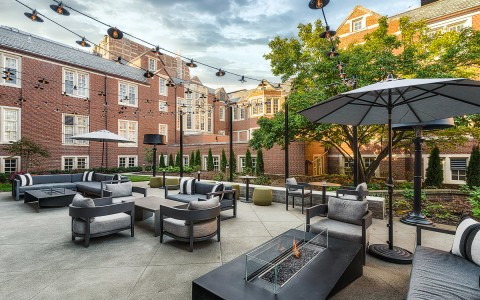 outdoor patio area with fireplace and seating