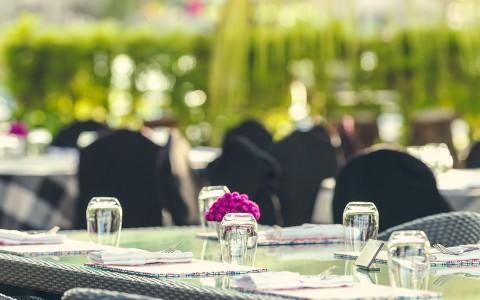 table set for event on outdoor patio