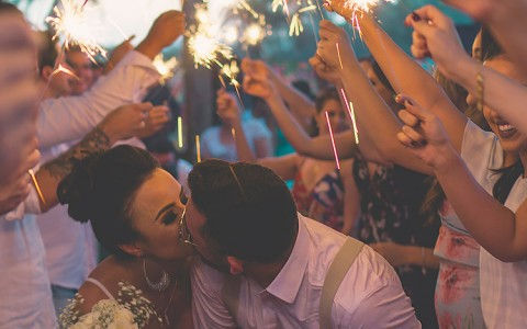 couple kissing under sparklers