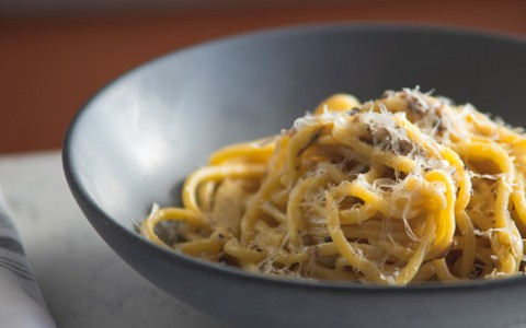 Bowl of pasta with parmesan cheese on top
