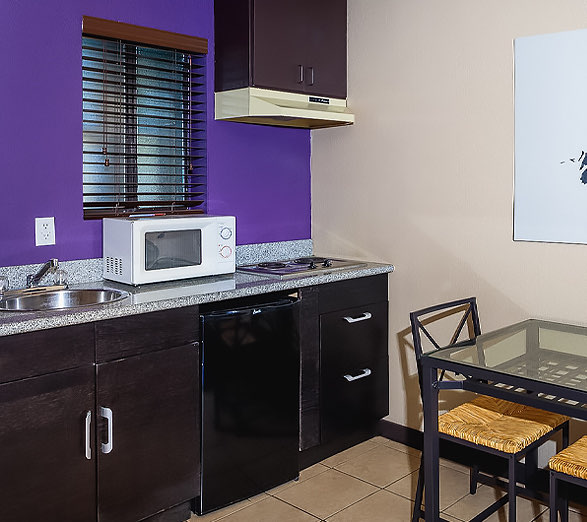 kitchenette with purple wall