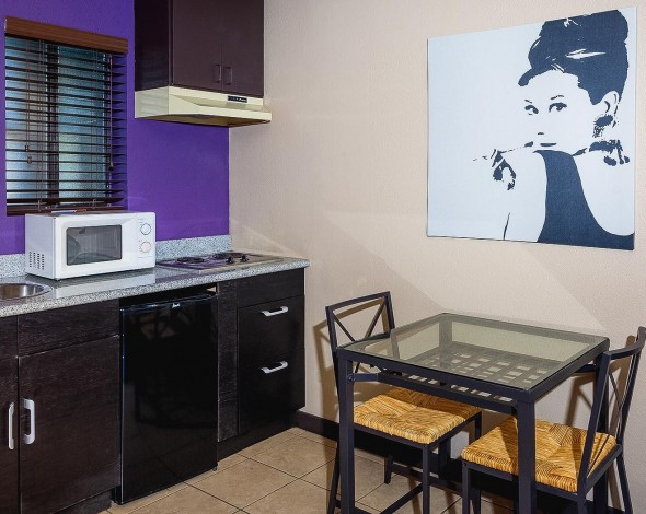 kitchenette and table with audry hepburn picture
