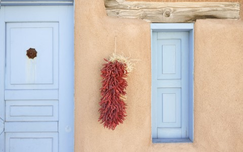 red chillies hanging on wall