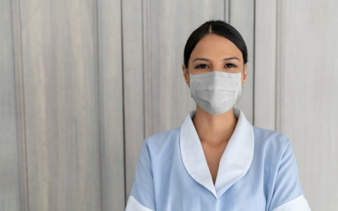 hotel housekeeper with mask