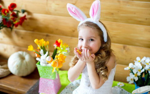 little girl on easter wearing bunny ears