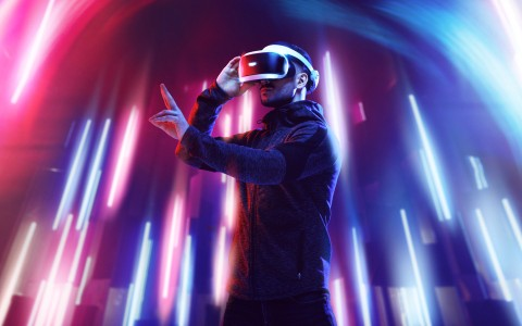 man with virtual reality glasses and neon lights