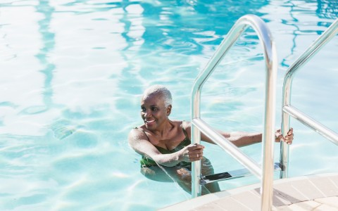 older woman getting out of the pool