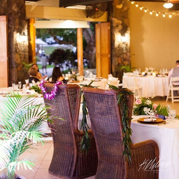 whicker chairs for the couple with leis
