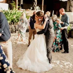 newlyweds kissing while they dance