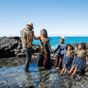 engagement photos of bride groom and their children on the ocean rocka