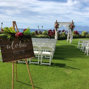 a wedding ceremony setup on the lawn