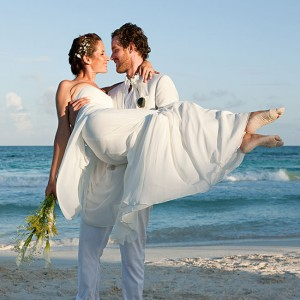 a couple walking on the beach after their wedding