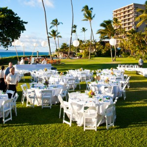 tables set up on the lawn for a reception