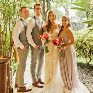 bride and groom posing with two from their bridal party