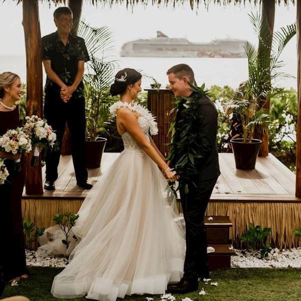 bride and groom at the altar wearing hawaiian leis