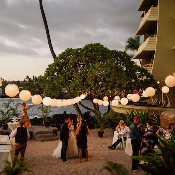 nighttime wedding ceremony with patio lighhts