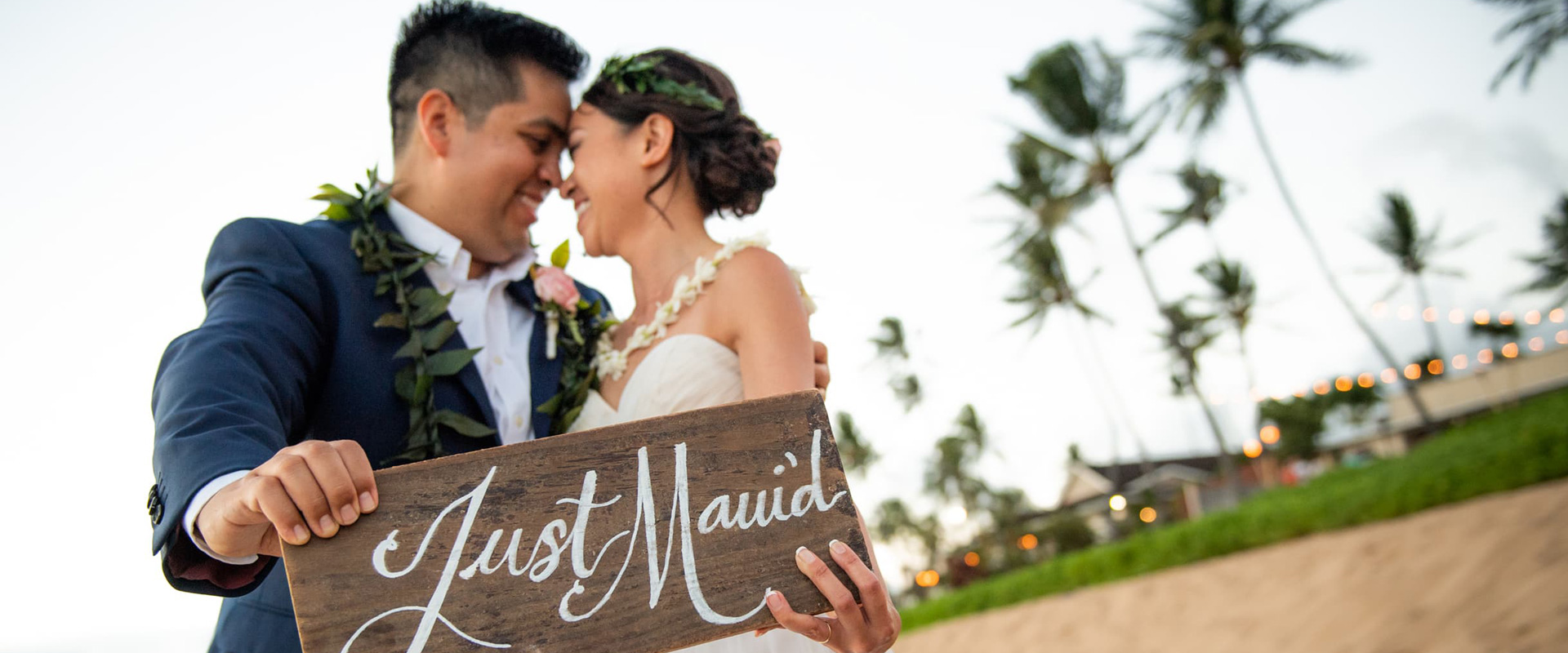 a couple holding a just married sign