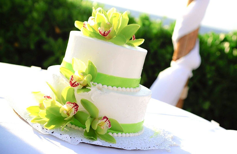 a white and lime green wedding cake