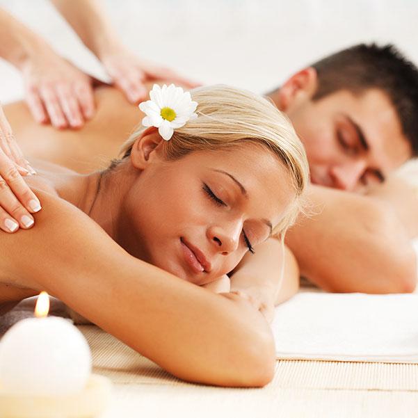 a couple getting a massage at the spa