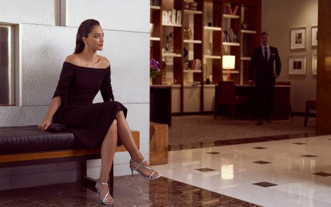 Woman sitting in lobby