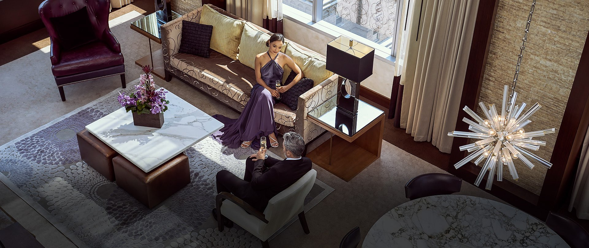 overhead view of woman sitting in hotel suite