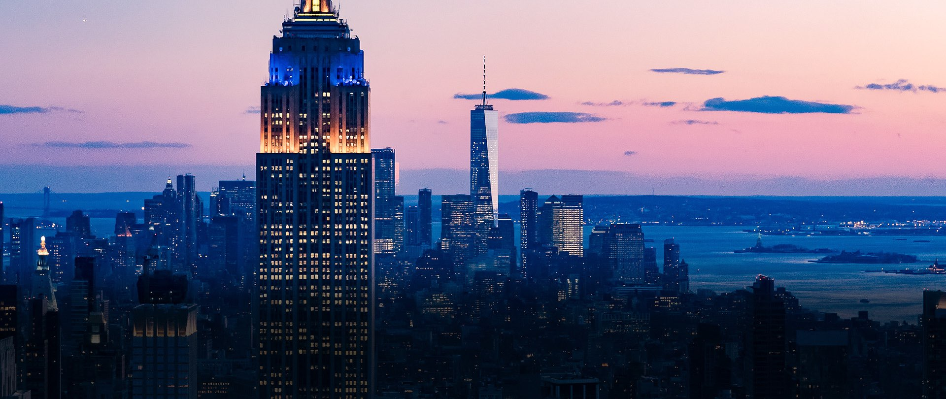 the new york skyline at dusk
