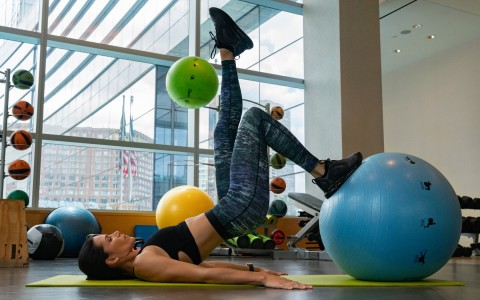 woman exercising with yoga balls