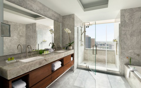 Bathroom with two sinks, shower and tub