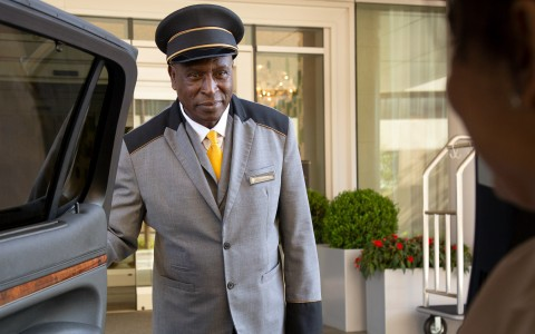 Hotel staff opening car door