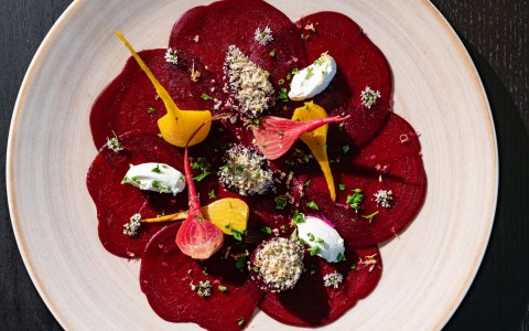 Beet spread on plate with vegetables