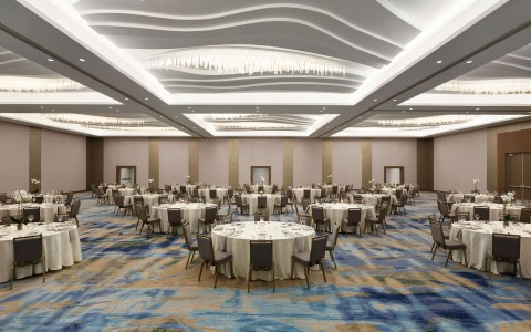 Large event space with round tables set