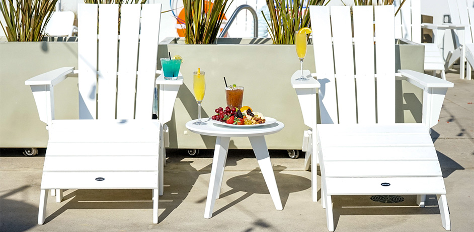 White outdoor chairs with drinks and food