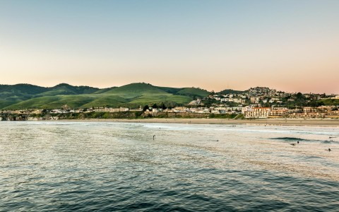calm waters in pismo beach with view of city