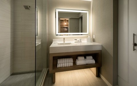 a guest bathroom with one vanity