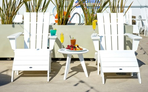 white lawn chairs with plate of food