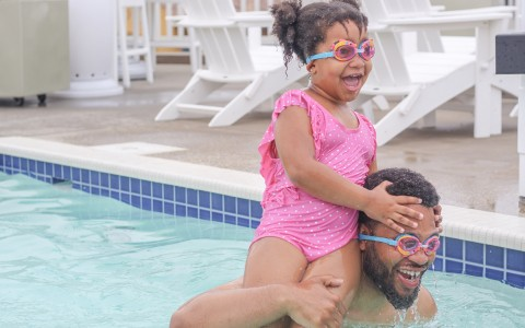 father and child in pool