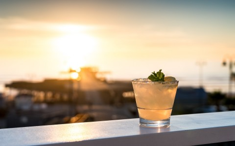 a cocktail on the patio at sunset