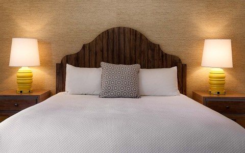 a bed with wood head board