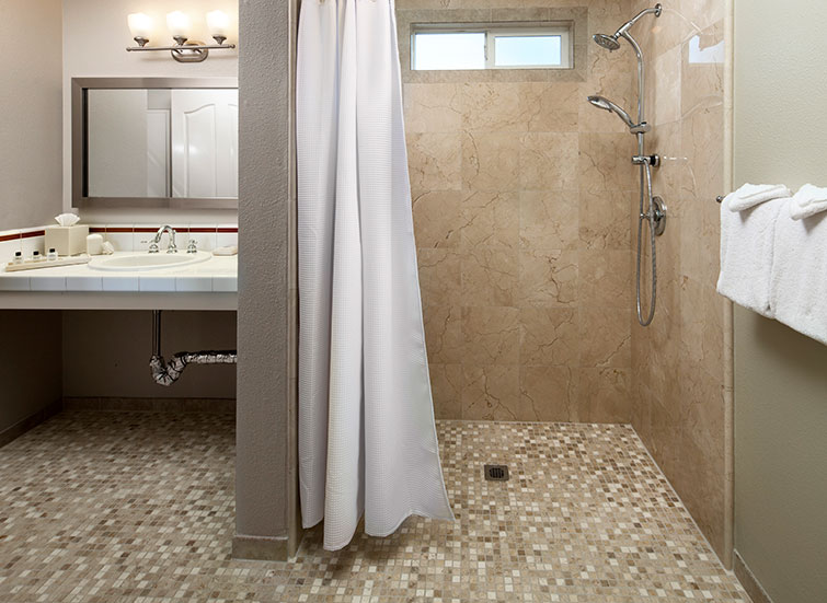 Hotel bathroom with roll in shower