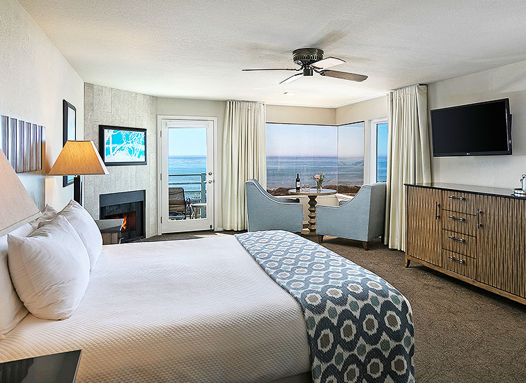 Hotel bedroom with ocean view and balcony