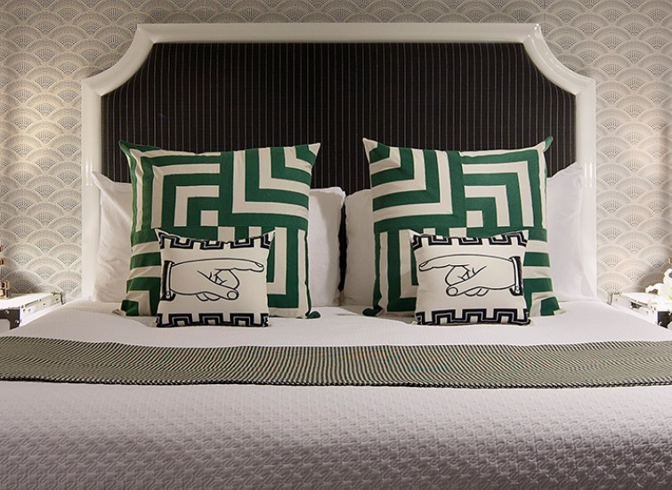 bed with green and white decorative pillows