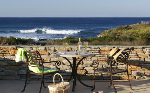outdoor dining table with view of ocean
