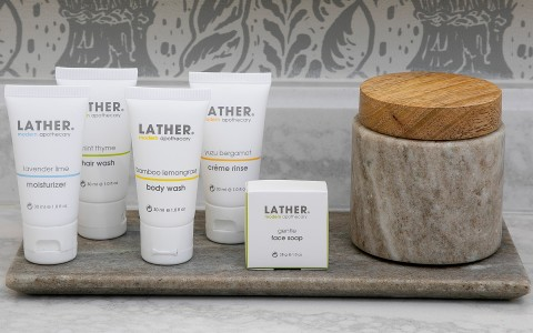 closeup of Lather brand bathroom amenities