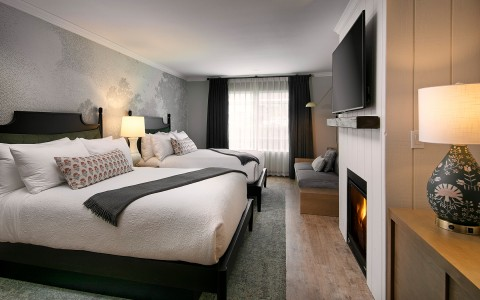 2 bed hotel room with fireplace