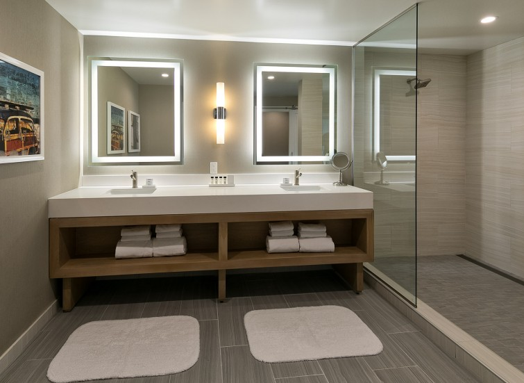 a bathroom in a suite with double vanity