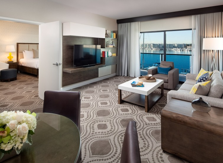 a one bedroom guest suite with view of the marina